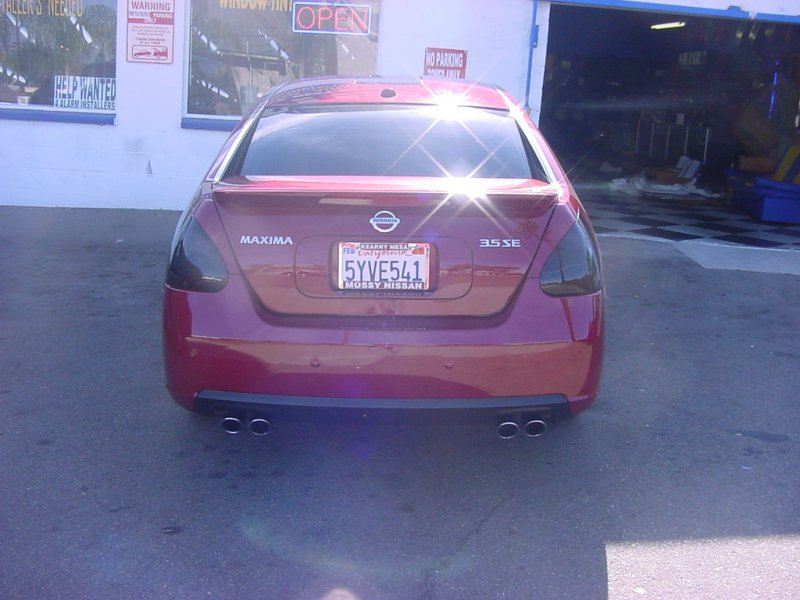 Red Maxima with black taillights
