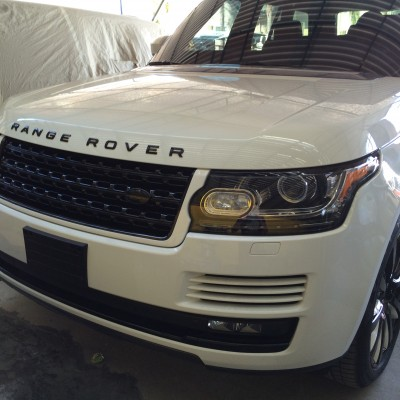 White Range Rover with Custom Lights and Wheels