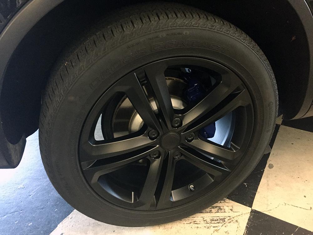 Black VW Beetle with black gunmetal wheels