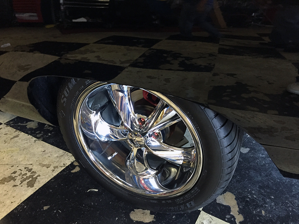 Chip Foose chrome wheels on classic Chevy Impala